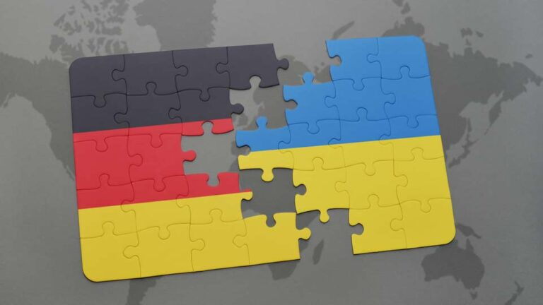 puzzle with the national flag of germany and ukraine on a world map background. 3D illustration